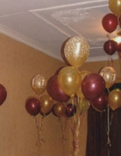 Maroon and gold 1st birthday table bouquets